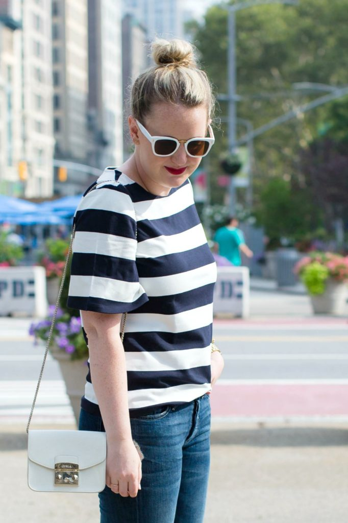 Meghan Donovan of wit & whimsy wears a striped tee with boyfriend jeans
