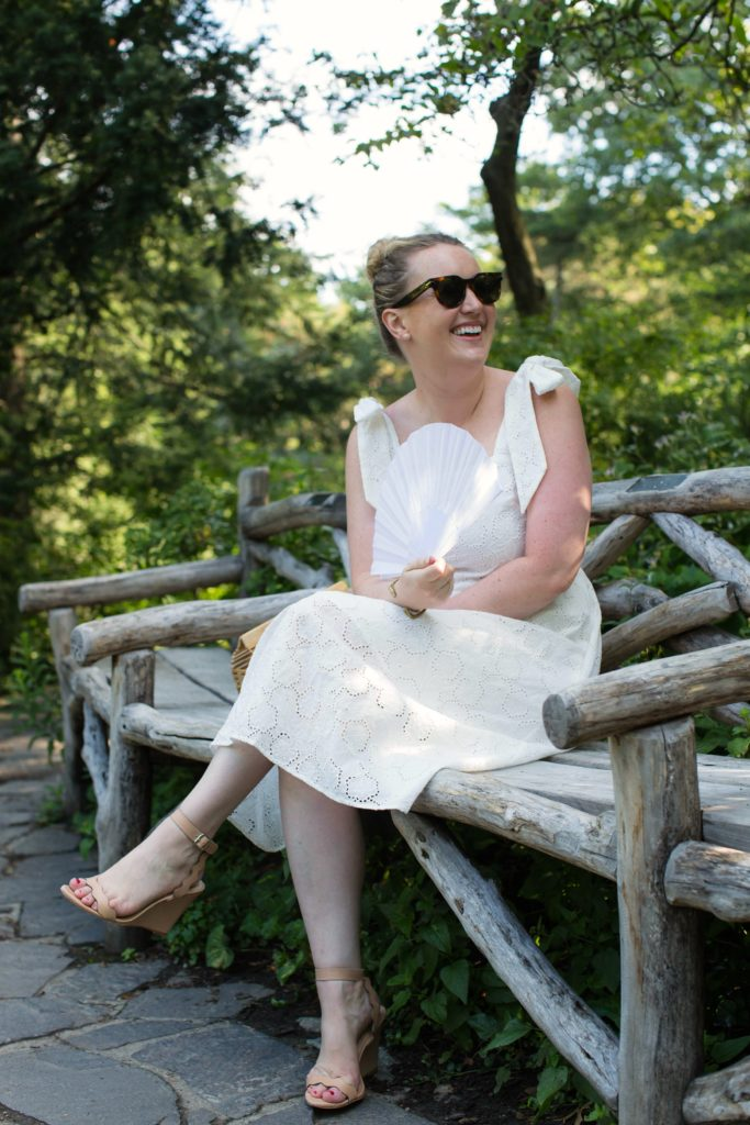 Meghan Donovan of wit & whimsy wears an eyelet dress in Central Park