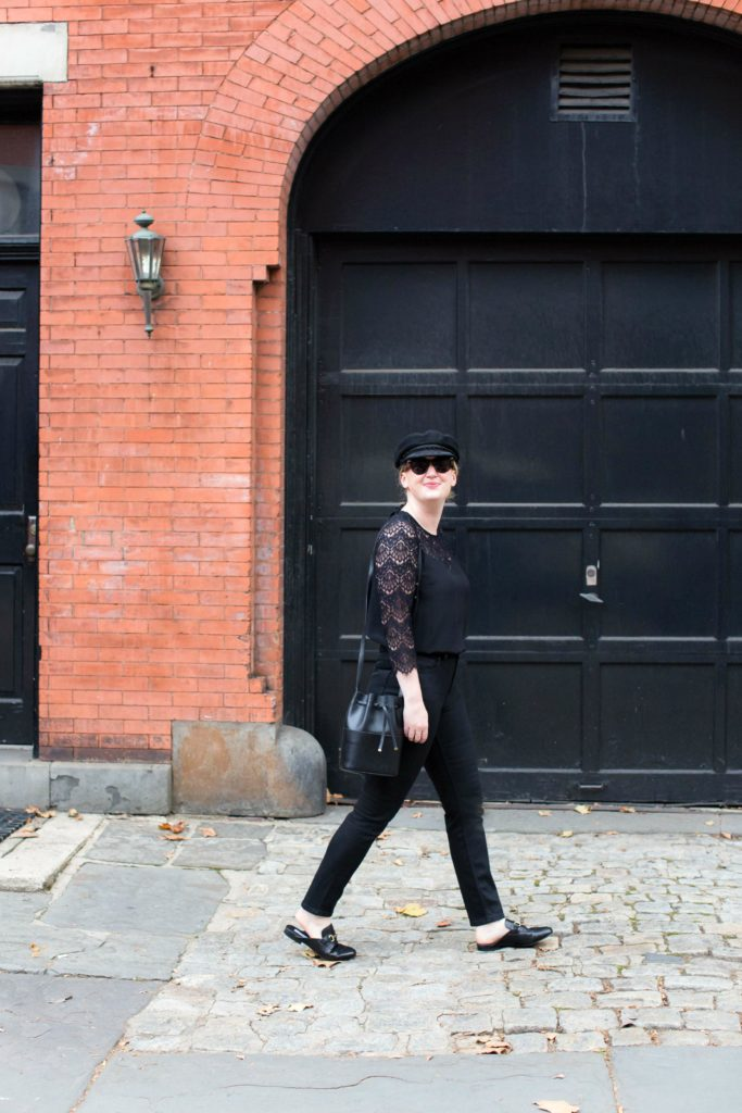 An All Black Look styled with a newsboy cap