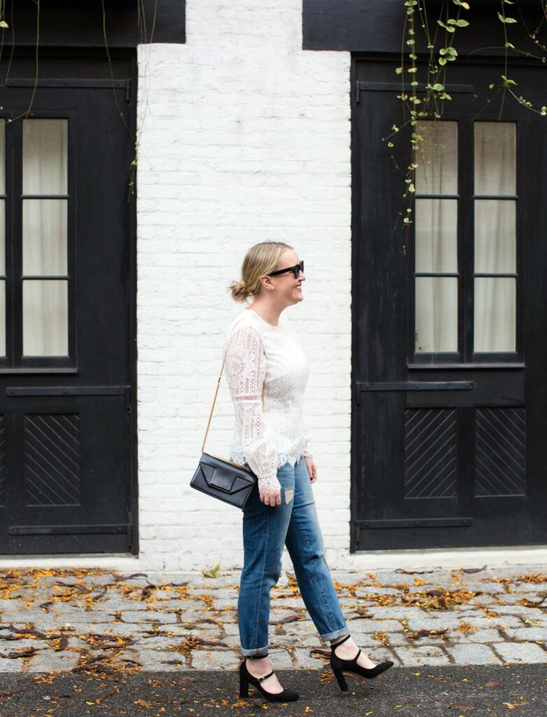 Meghan Donovan wears a lace top with boyfriend jeans and Mary Janes