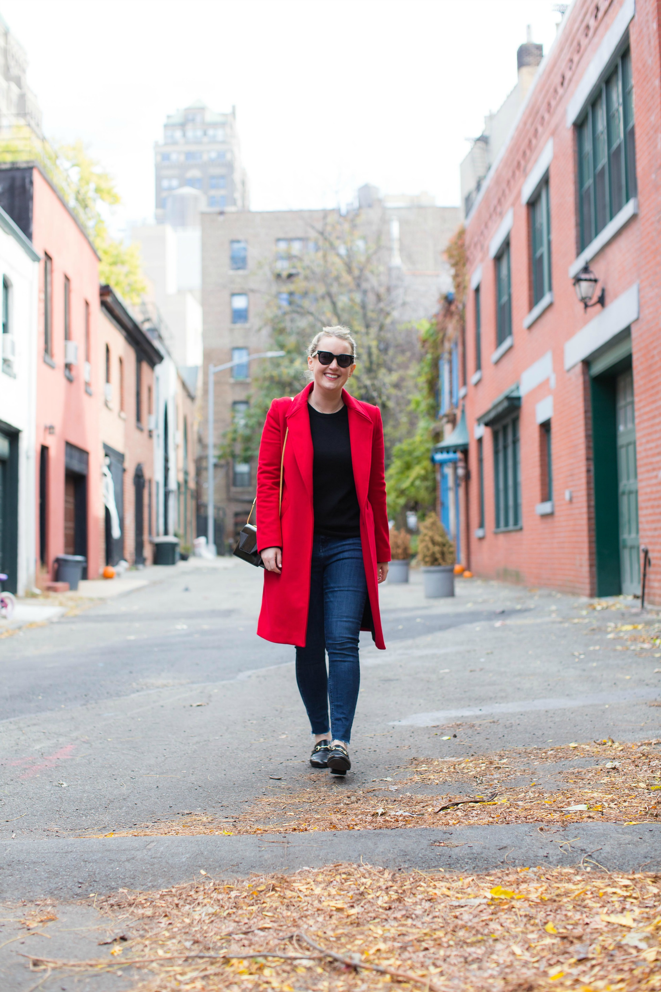 Meghan Donovan styles a red coat